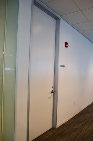 BTG Pactual white door hallway
