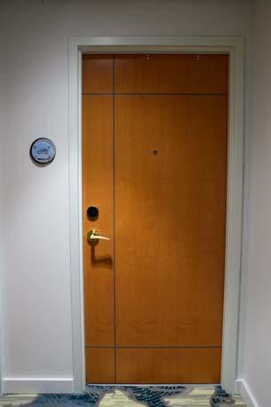TRYP Hotel wood door left